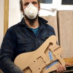 Deimel Guitarworks - Johannes getting ready for sanding