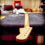 Deimel Guitarworks - highly figured maple neck gets sanded for next varnish