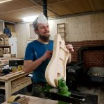 Johannes sanding a Deimel Firestar body