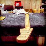 Deimel Guitarworks - highly figured maple neck gets sanded for next varnish