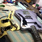Deimel Guitarworks - Frank is mounting the guitar
